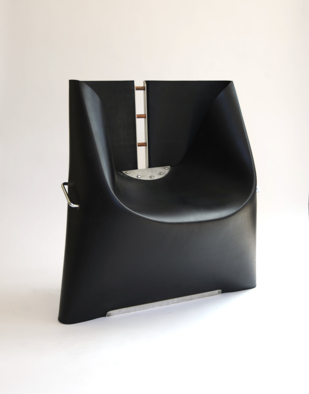 Black Rubber Chair Henner Kuckuck Unknown Origin Unknown Date Rubber & Metal Seat Back H 26 in, W 18 in, D 13 in, (Seat H: 11 in adjustable) LIST PRICE: $2,800 DESIGNER DISCOUNT PRICE: $ LEAD TIME: 3-5 Days Shipping & Handling QUANTITY IN STOCK: 1 ONLINE PLATFORMS: kM Web, Artsy