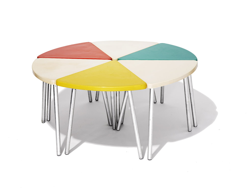 Pie Table     Unknown Designer      Unknown Production      USA     1960s     fiberglass with hollow tube steel base      H 18.5 in, D 41.5 in, Individual Slice D 20 in     LIST PRICE: $625    DESIGNER DISCOUNT PRICE: $531.25    LEAD TIME: 3-5 Shipping & handling    QUANTITY IN STOCK: 1    ONLINE PLATFORMS: kM Web, Artsy, 1st Dibs