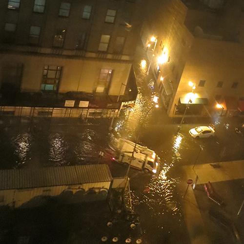 The surge begins flooding the neighborhood.