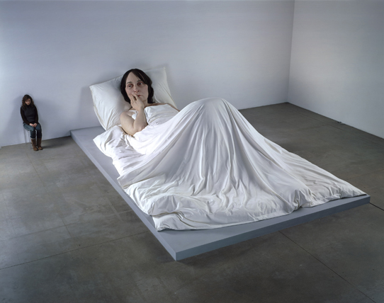 Ron Mueck (Australian, b. 1958).  In Bed , 2005. Mixed media, 63 3/4 x 255 7/8 x 155 1/2 in. (161.9 x 649.9 x 395 cm). Private Collection (  Source  )