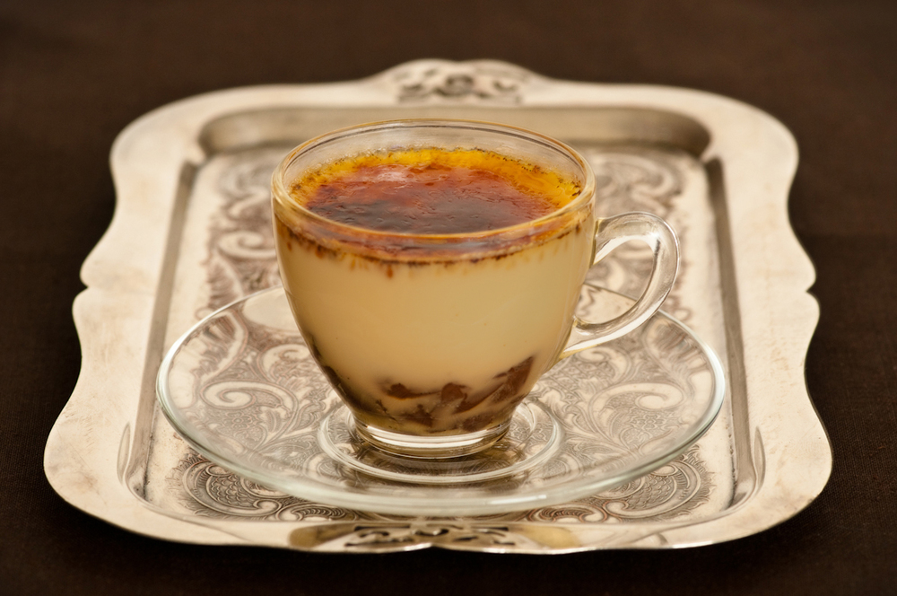 silver tray with creme brulee in espresso cup