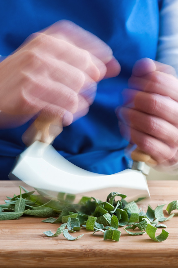 chopping sage with a mezzaluna
