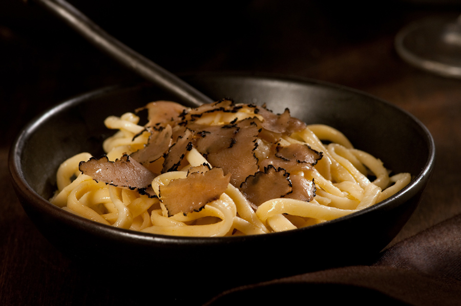 black truffles shaved over homemade pasta