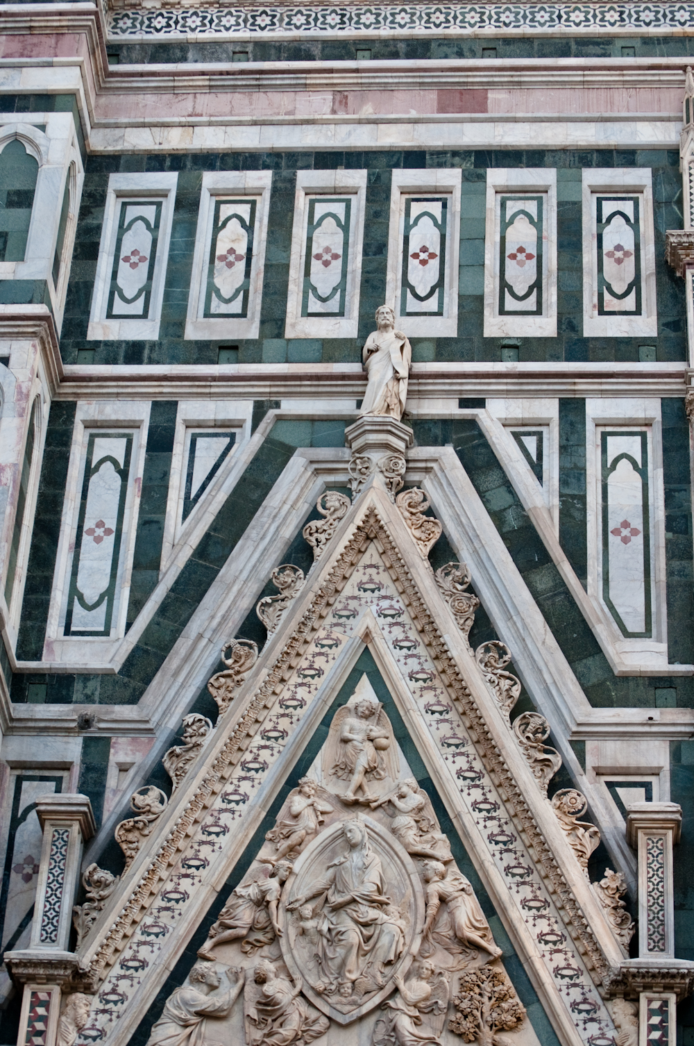 The cathedrals original facade was dismantled in 1588 and replaced with a colorful Neo-Gothic facade clad with white, green, and pink Tuscan marble.