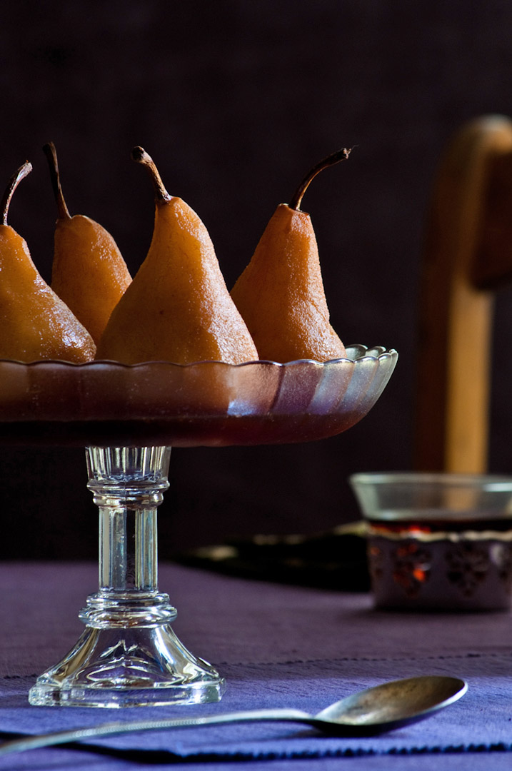 poached pears in glass serving dish