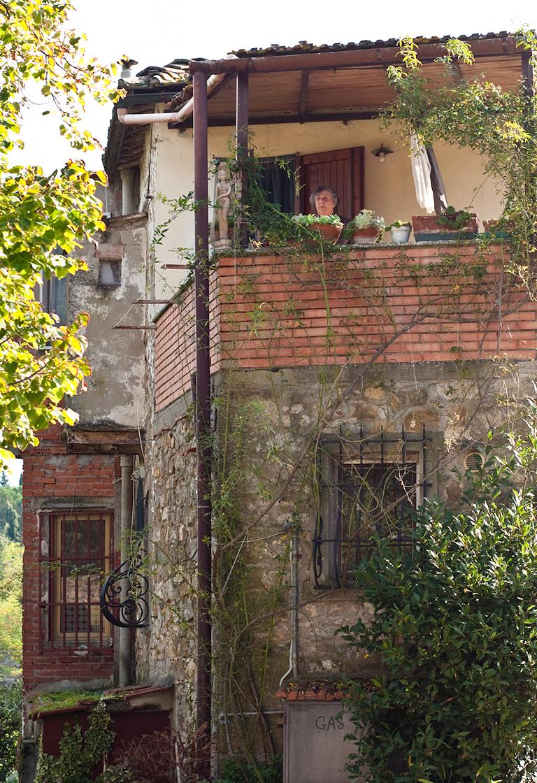 Tending the herb garden on the balcony, Panzano in Chianti.