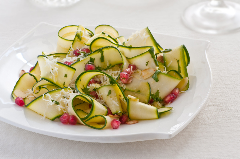 shaved zuchini with pomegranate seeds and almonds