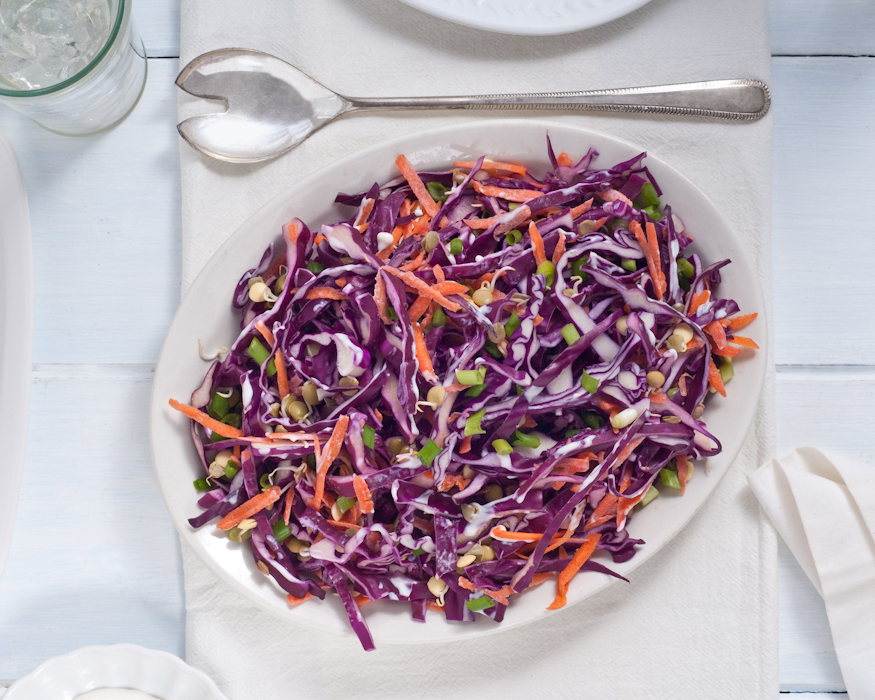 winter coleslaw with sprouted lentils in garlic dressing