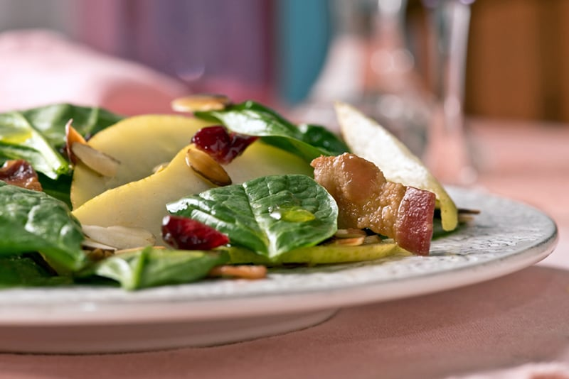 winter salad with pears cranberries and bacon