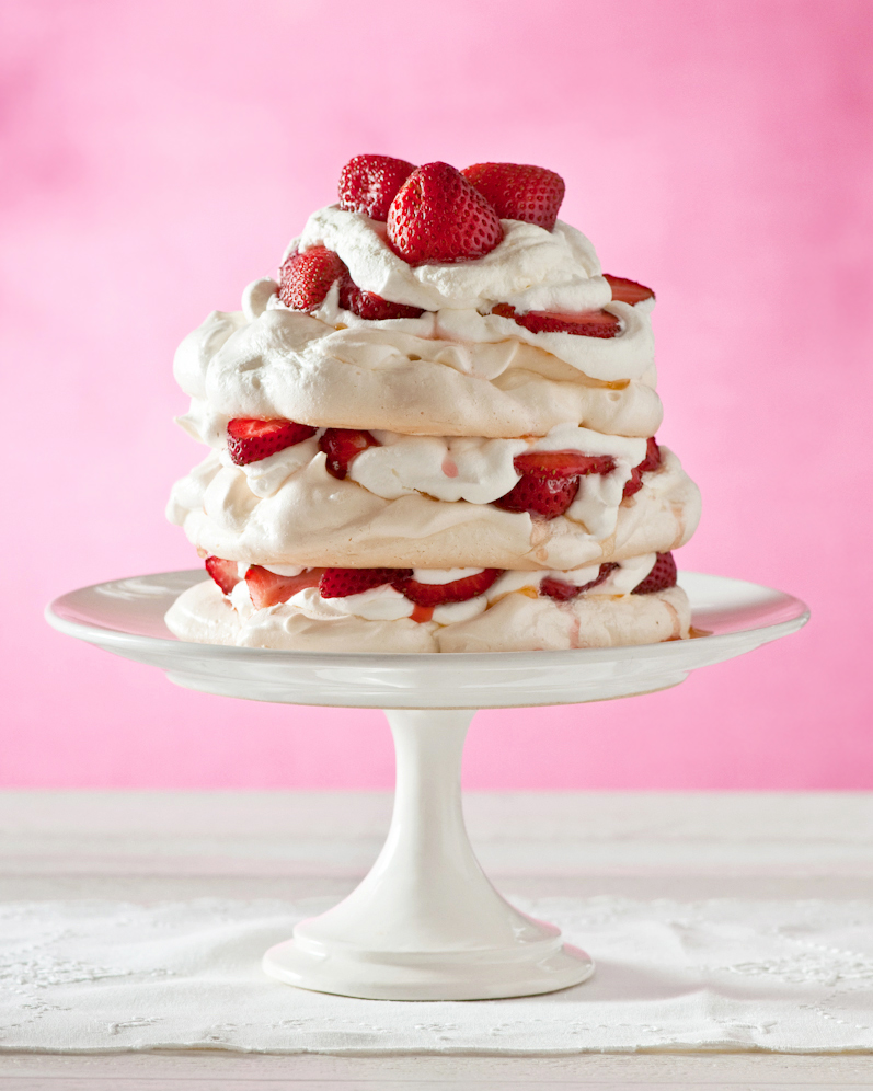 A rosy pink backdrop not only intensifies the redness of the berries, but acts as a subtle reference to the special ingredient in this  Strawberry Rosewater Pavlova .