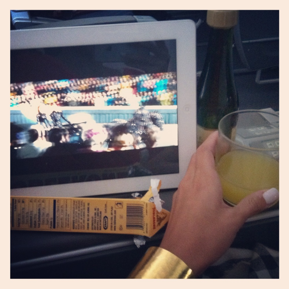 (BECK CUFF) - Mimosas, chocolate & Hunger Games... not getting bored on this flight!