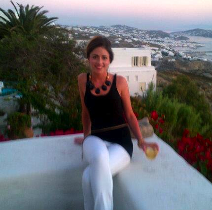 Chloe wearing statement BECKlace in Greece