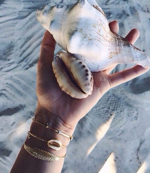 Gold arm party at the beach...