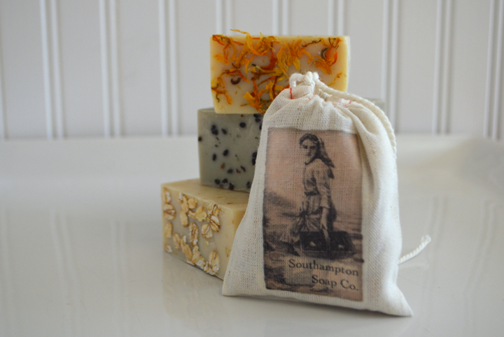 Sachet that Griffin Stuffs with soap. Soap Bars: Top - Calendula, Middle - Seaside Spa, Bottom - Oatmeal Almond
