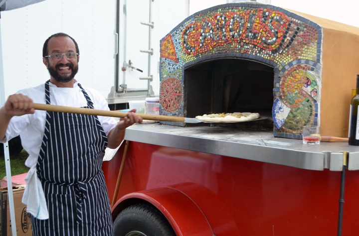 Chef Arjun Achuthan, manning the mobile pizza oven
