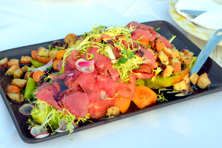 Tuna crudo with frisée, green zebras tomatoes, sungold tomatoes, red radishes, purple Cherokees, avocado, and garlic croutons. Dock to Dish Yellowfin Tuna caught by Captain Ralph Towlen by Rod and Reel