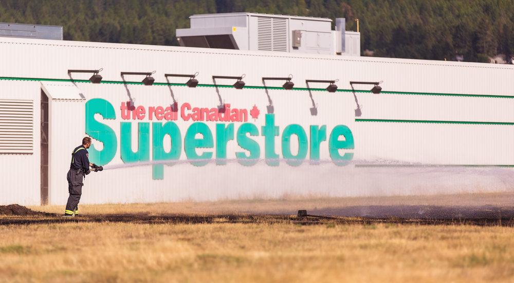 Cranbrook Fire puts out grass fire behind the superstore in cranbrook - CFD Puts out grass fire.