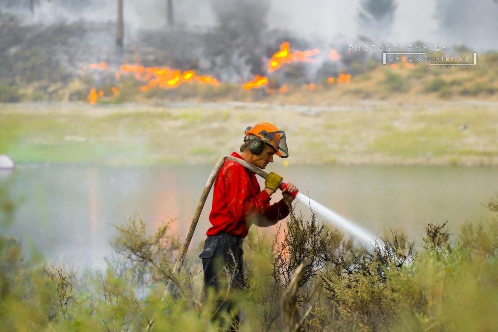 Ground crews work hard extinguishing hot spots -