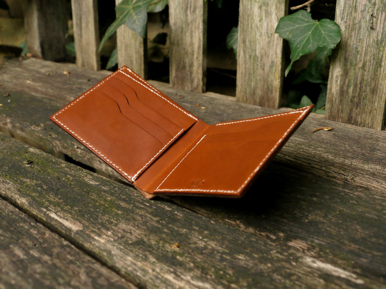 A brown veg tan Billfold with nine pockets