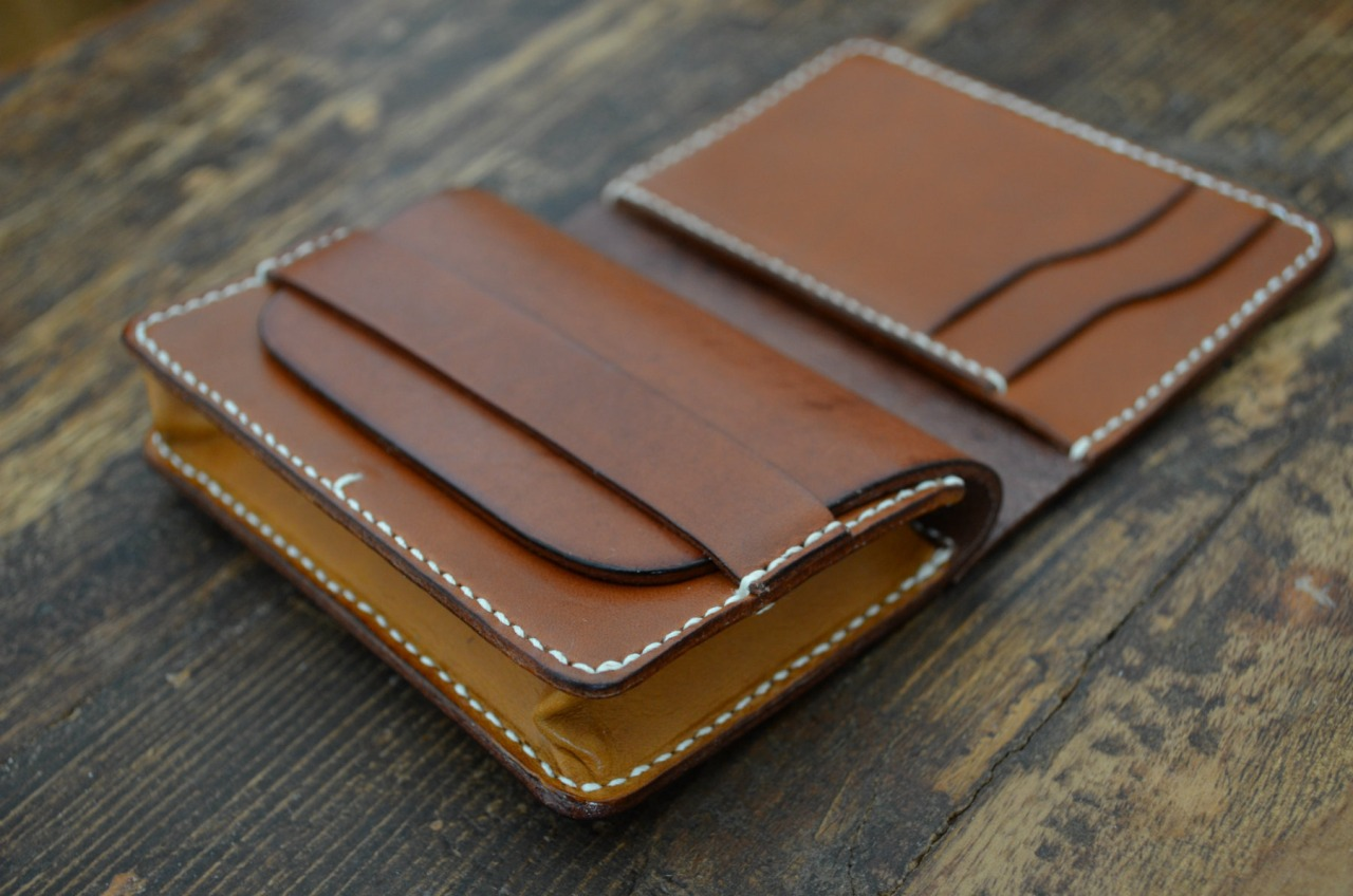 After months of development here it is - M.E.S Gusset Wallet - prototype. Made of almond and walnut Vegetable tanned cowhide, hand sewn with beeswaxed linen thread.