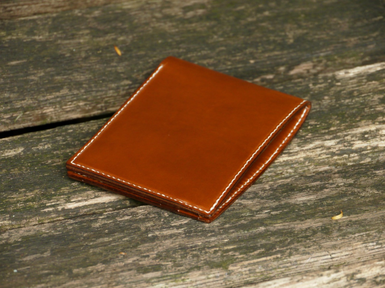 A brown veg tan Billfold with 9 pockets, much thinner than my regular wallets ( 145£ + shipping / contact mes.leather@gmail.com to purchase ) fine, cream linen thread ( 7stitches per inch ) Interior lined with light brown leather