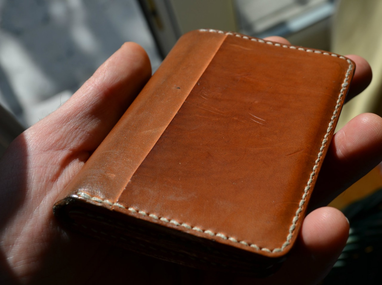 This wallet is being worn about 4months, left outside couple of times. Evolution of patina has started from pale, natural color ( see the natural state of exactly same leather )