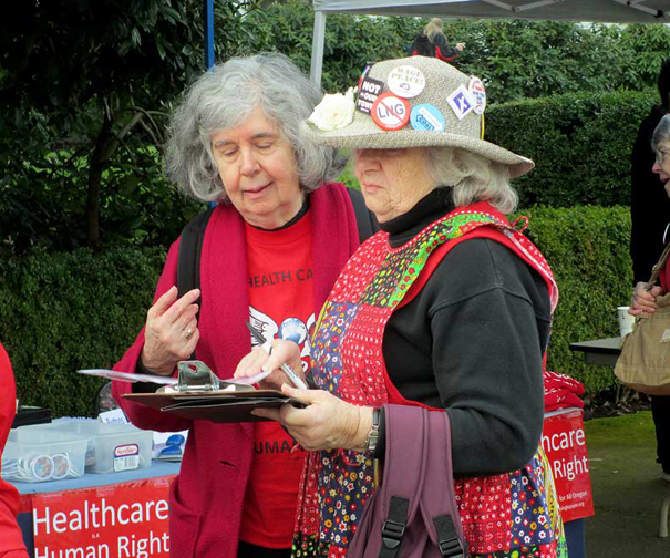 Joanne Cvar helps Carolyn Powers, Corvallis Raging Granny, fill out form.jpg