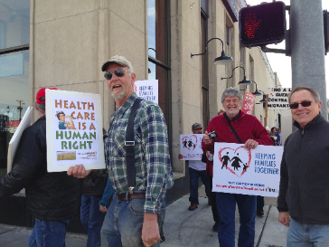 Peter Hall, ORA Blue Mountain Chapter Chair, Bill Whitaker, HCAO Board Treasurer and local Action Team Co-Chair and Glen Scheele, Union County Democrats Chair, march together for Just Immigration Reform and Health as a Human Right.