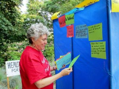 Rose Hart, at the Writers Wall. MVHCA Medicare Birthday Party. Photo by Roberta Hall.