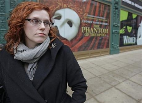 In this Dec. 3, 2013 file photo, actor Adrienne Matzen poses in Chicago's theater district. Matzen, 29, who has been mostly uninsured since she turned 21, is now looking for a low monthly premium insurance plan on the federal website. High deductibles for health plans available on the Illinois insurance exchange may contribute to sticker shock when people start paying medical bills in 2014, if they have elected to pay for insurance under the Affordable Care Act. (AP Photo/M. Spencer Green)