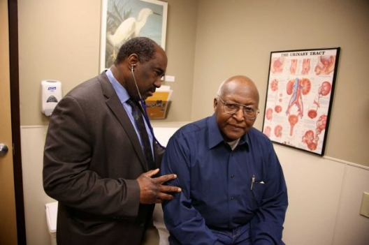 This photo taken Feb. 24, 2014, provided by the Roswell Park Cancer Institute, shows Dr. Willie Underwood, a urologic oncologist at Roswell Park Cancer Institute, examining patient Richard Waldrop at the Roswell Park Cancer Institute, in Buffalo, N.Y. Cancer patients relieved that they can get insurance coverage because of the new health care law may be disappointed to learn that some of the nation's best cancer hospitals are off limits. Only four of 19 nationally recognized comprehensive cancer centers that responded to an Associated Press survey said patients have access through all the insurance companies in their state's exchange, or primary market. Photo: Bill Sheff, AP