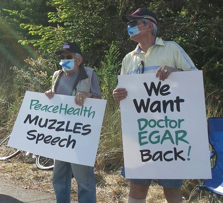 Florence residents protest Peace Nealth firing of their doctor, May 1, 2014.