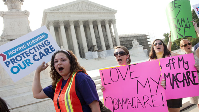 Demonstrators in favor of President Barack Obama's healthcare legislation await a decision by the Supreme Court outside the Supreme Court in Washington, June 28, 2012. Saul Loeb/AFP/Getty Images