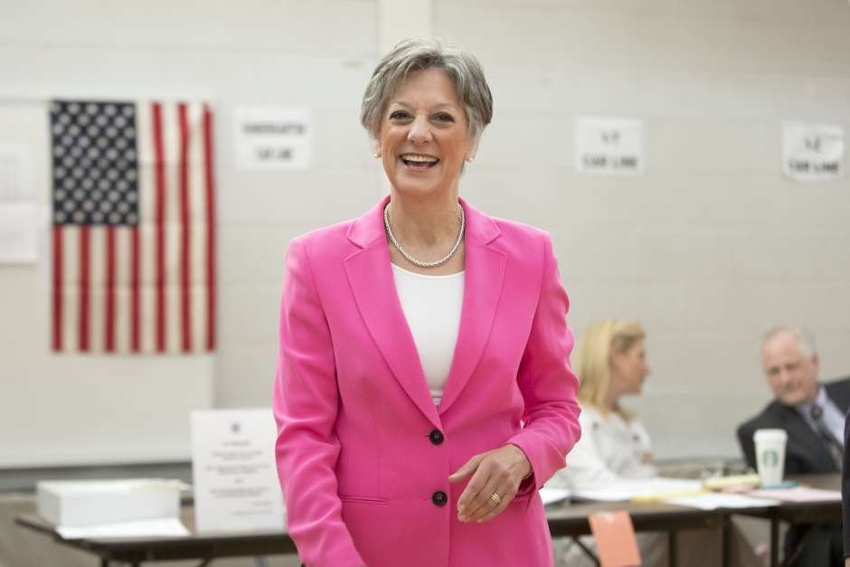 FormerU.S. Rep. Allyson Schwartz,walks from the booth after voting Tuesday, May 20, 2014, in Jenkintown, Pa. Matt Rourke/AP