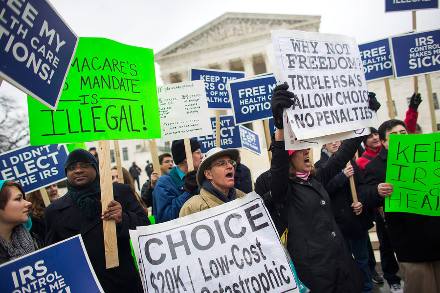 People protesting against the Affordable Care Act rallied outside the Supreme Court in March, before arguments in the second major challenge to the law. Jim Lo Scalzo/EPA/Landov