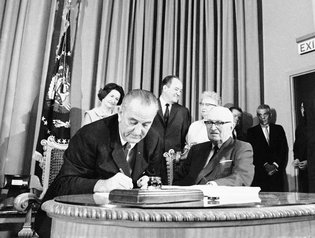 President Lyndon B. Johnson, left, with former Pres. Harry S. Truman at his side,  signed the Medicare bill on July 30, 1965. Credit Associated Pres
