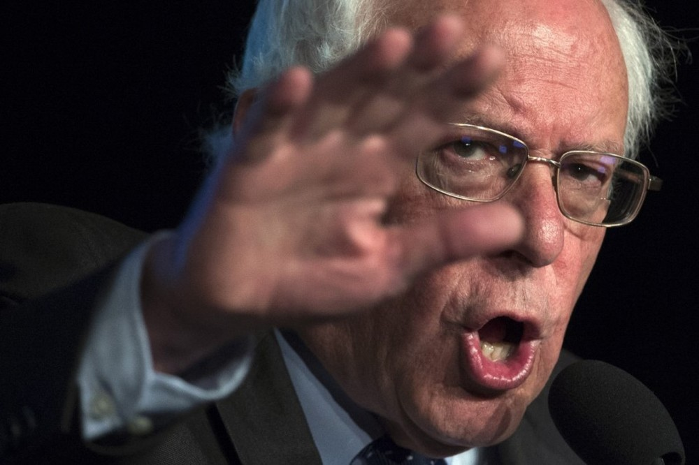"Sen. Bernie Sanders (I-Vt.) said Thursday that he would introduce legislation ""in the very near future"" that would make health care a right. (Molly Riley/AP)"