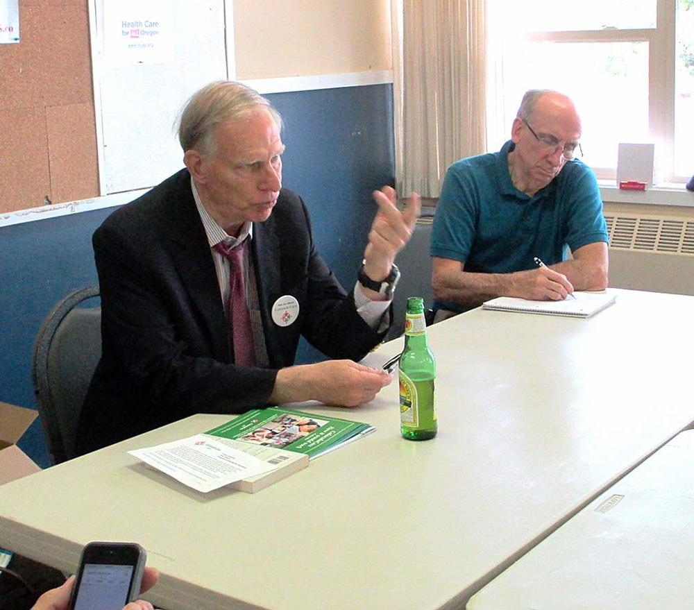 T.R. Reid shares information with the HCAO Board, July 25, 2015. Michael Huntington, MD, at his left. Photo by Bobbi Hall.