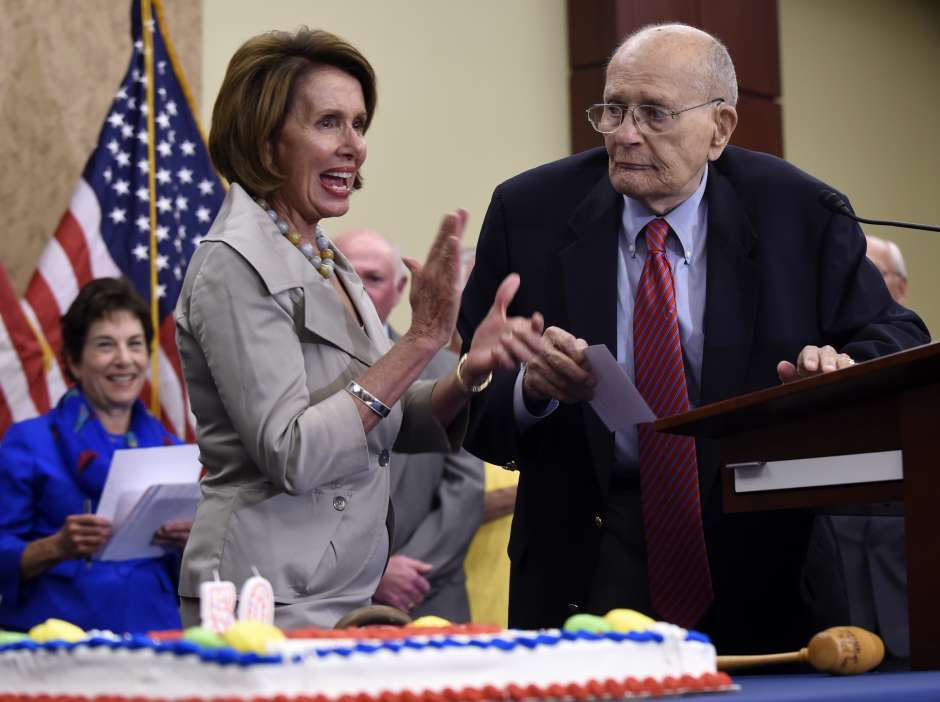 House Minority Leader Nancy Pelosi of Calif. applauds former Michigan Rep. John Dingell during an event marking the 50th anniversary of Medicare and Medicaid, Wednesday, July 29, 2015, on Capitol Hill in Washington. Susan Walsh/AP