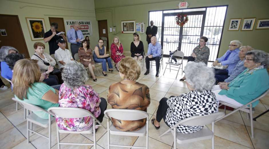 he Dr. Amando Badia Senior Center in Miami hosted a 2014 round table featuring Florida Gov. Rick Scott where a group of senior citizens expressed their concerns on how proposed cuts to Medicare Advantage plans would affect them.  Alan Diaz/AP