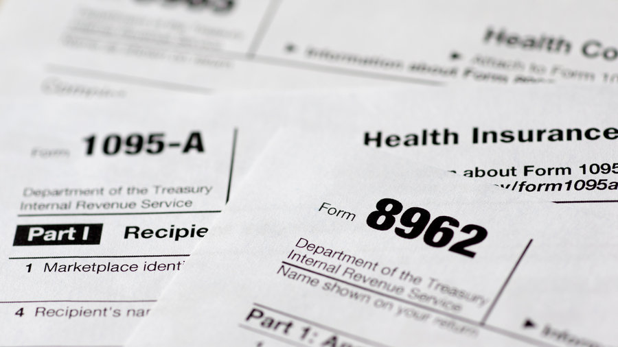 The IRS released preliminary figures that show about three-quarters of taxpayers indicated they had qualifying health insurance in 2014. Carolyn Kaster/AP