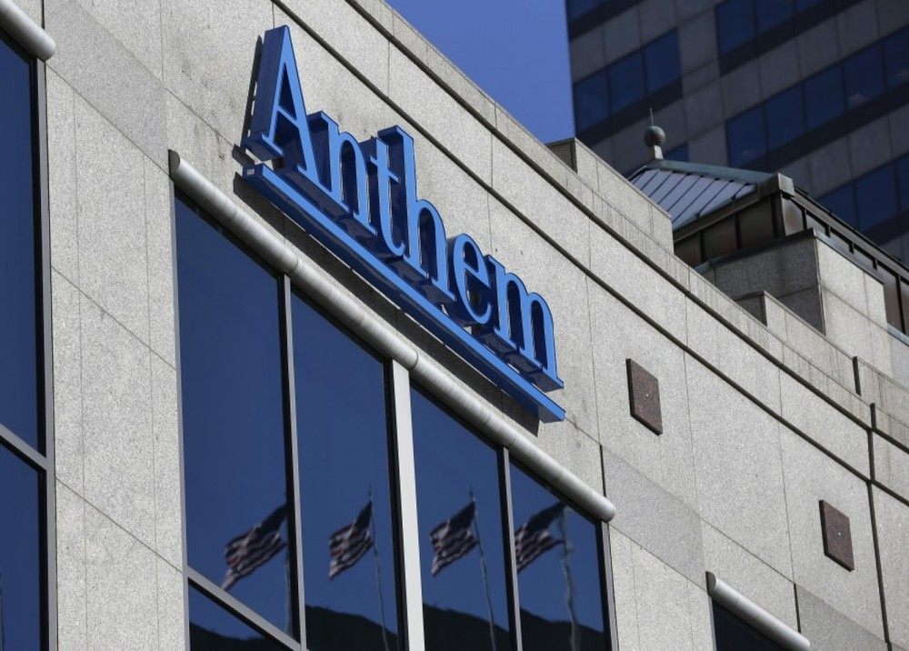 he Anthem logo hangs at the health insurer's corporate headquarters in Indianapolis. (AP Photo/Michael Conroy)