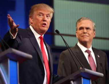 Donald Trump speaks as former Florida Gov. Jeb Bush listens during the first Republican presidential debate in August, 2015. Andrew Harnik/AP.