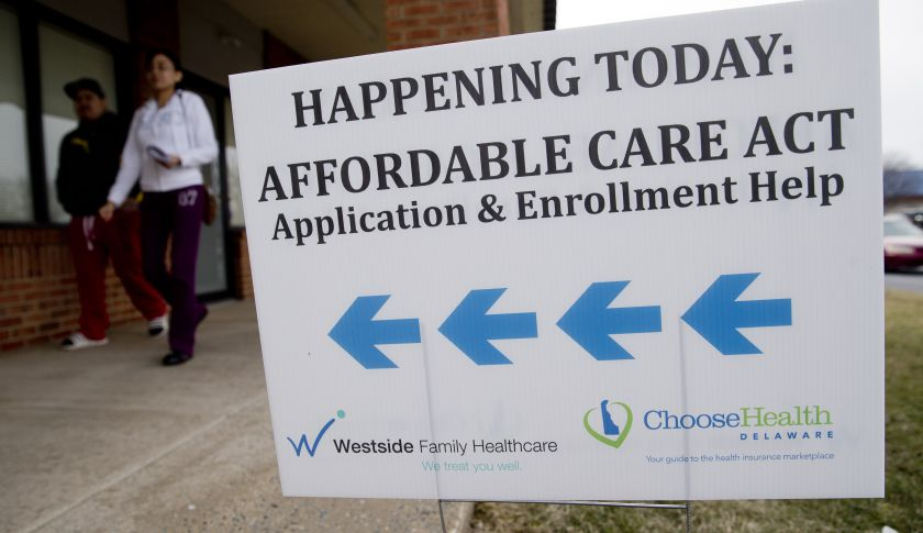 An Affordable Care Act application and enrollment help sign stands outside a Westside Family Healthcare center in Bear, Delaware, U.S. Photograph by Andrew Harrer — Bloomberg via Getty Images