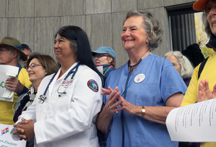 tate Sen. Irene Aguilar, D-Denver, and former state Sen. Jeanne Nicholson, D-Black Hawk, rally supporters for ColoradoCare, a ballot initiative to provide universal health care for state residents, on Oct. 23 in Denver. The measure will be on the November 2016 ballot as Amendment 69.  Photo by Vic Vela/The Colorado Statesman