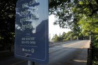 A sign posted near the Vista Bridge in Portland urges people contemplating suicide to seek help.