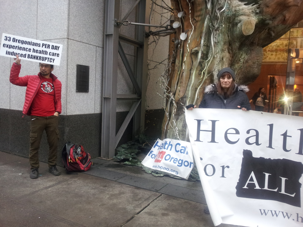 Hyung Nam and Lisa Stiller demonstrate in front of the Moda office building,December 14, 2015