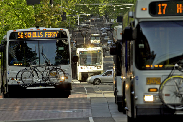 TriMet buses and MAX trains pick up passengers on May 11, 2012 in downtown Portland.      ( The Oregonian /file)