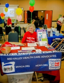 Bobbi Hall tabling at the MVHCA table, Corvallis Senior Center, May 31, 2017. Photo by Ricardo Small