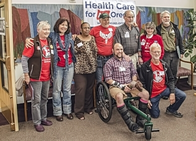 Some of the HCAO Board members and officers: Mary Lou Hennrich, Sandra Hernandes, Glendora Claybrooks, Tom Sincic, Bud Laurent, Cheryl Simpson, Mark Lindgren, in wheelchair Nico Serra, kneeling Charlie Swanson